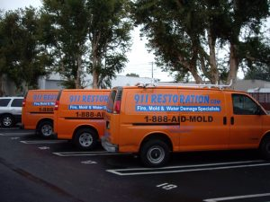 911 Restoration vans in parking lot